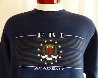 vintage 90's Federal Bureau of Investigations FBI Academy Quantico navy blue fleece graphic sweatshirt metallic gold white seal crest large