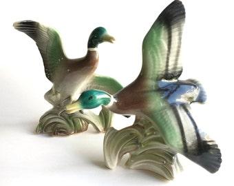 pair of vintage mid century ceramic duck figurines. kitsch flying bird statues. retro home decor.