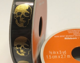 3 yard roll of black and gold skull ribbon, 5/8 inches wide (BR88)