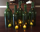 Wine Bottle Hurricane Candles- Set of 5 green hand cut wine bottle hurricanes 3 large and 2 regular bottles