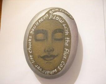 Flow with the flux poem meditation face art stone.