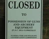 One sided FLORIDA Fish and Wildlife metal sign -- CLOSED to possession of guns, etc.