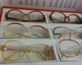 Bugs Bunny vintage eyeglass display box with 6 vintage Eyeglass frames from the 80s inside.