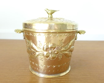 Embossed and etched lidded brass stash box with bird finial