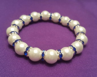 Beautiful White Pearl Stretch Bracelet with Sapphire Blue Crystal Spacers Throughout