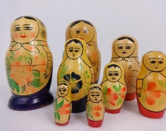 Vintage Russian Nesting dolls two sets go together, made in the USSR , Purple Blue and Red hand painted (a few cracks in wood).