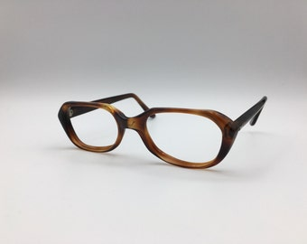 Very Unique Cateye Victory optical glasses tortoise shell coloring with metal detailing on arms 1960's
