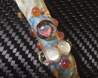 Heart Glass piece fumed one hitter.  Hand blown Heart Millie with highlights. Color changing.  Flat mouth piece