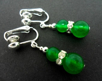 A pair of pretty green jade  bead  dangly clip on earrings.