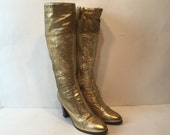 size 8 / 1970s gold leather go go boots