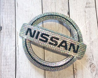 Bling car emblem- sparkly auto emblems- bling auto parts- bling car logos- bling nissan logo- bling car accessories- custom car accessories-
