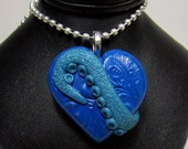 lovecraft Heart Pendant , Polymer Clay bead in cobalt with glow in the dark blue , tentacle, squid, cephalopod