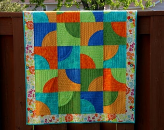 Bright baby quilts on sale - traditional curved patch quilt block quilt in bright colors of blue green and orange