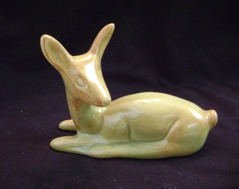 Vintage Yellow Green Glazed Deer laying down,