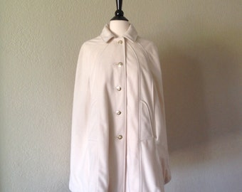 White 1960s cape coat / winter white cape has gold buttons and front pockets / 60s 70s style cape