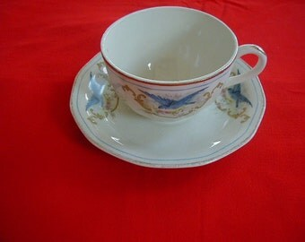 Lovely Blue Bird cup and saucer colonial china.