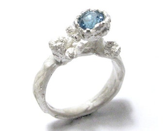 Secret garden ring with ocean blue topaz