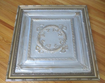 """FRAMED ANTIQUE CEILING Tile 28"""" x 28"""" In Goltone Wood Frame, The TIle Is Silver And Gold Wreath With Bow Design"""