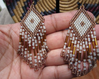Native American style beaded earrings, in tan and gold with fringe