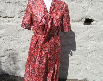 Vintage silk dress. Orange , pink, black paisley style print approx UK 12