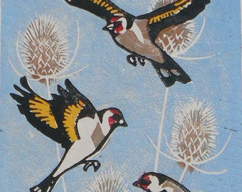 Goldfinches in flight linocut print