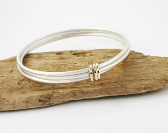 Sterling silver bangle set. Silver bangle bracelets with 14k solid gold hoops. Gold and silver bracelet. Handmade silver bracelet with gold.