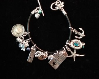 Beach Bum Charm bracelet over 15 charms,beads and crystals