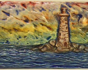1st light - lighthouse, colorful, rainbow, sky, cast ceramic relief art tile, ocean scene, daytime, watchful, warning, safety, anchored,