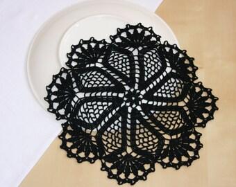 Black crochet doily