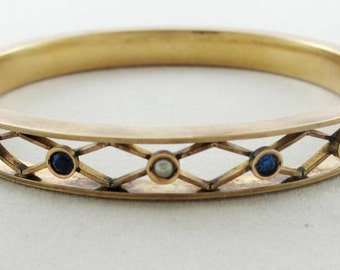 Early Century Jewelry: Antique 10K Bangle Bracelet in Trellis Motif with Seed Pearls and Sapphires
