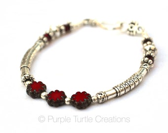 Silver bracelet with Czech glass picasso flower beads  |  Red
