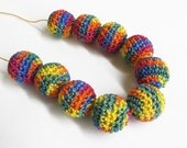 Crocheted beads 20 mm handmade yellow round balls acrylic yarn on wood