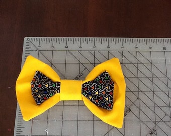 Yellow clown tie or hair bow