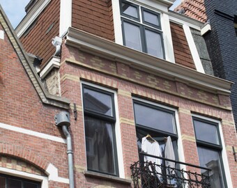 Building with Clothes Hanging in the Window - Architecture - Brick - Windows - Amsterdam - Travel - Europe - Photography - Home Decor