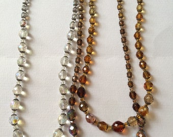 Two Vintage aurora crystal beads,  one double stranded necklace, one silver clasp single stranded necklace