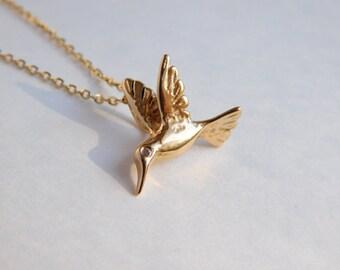 Hummingbird pendant with glistering diamond eye!