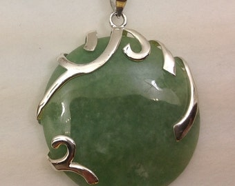Large sterling silver and Naphritr Jade disk pendant.