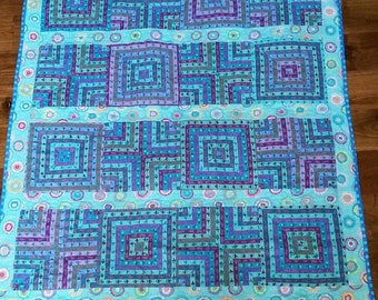 Blue quartered striped pattern lap or baby quilt in all Kaffe Fassett prints.