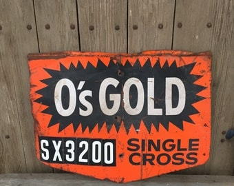 Vintage metal sign. O's gold metal advertising sign, farm advertising