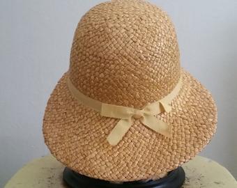 Vintage bright yellow straw sun hat.