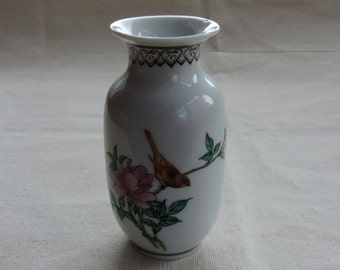 Vintage chinese vase with bird and peony blossom and chinese characters backstamped
