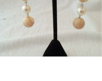 0150 ~ Mother of pearl dangling earring.