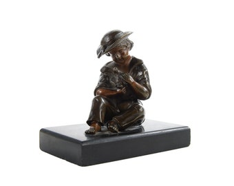 Boy playing with Chick-Vintage table top Bronze Sculpture