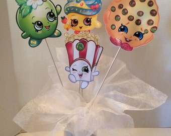 Shopkins - four five inch shopkins images on wooden skewers painted white. 12.00  Double sided