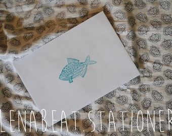 white envelope with fish light blue press.