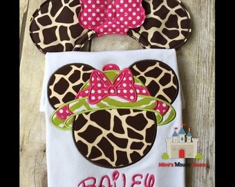 Minnie Mouse safari Giraffe animal print head with green Hat and pink/white dot bow on a white t-shirt. Inspired by Disney Animal Kingdom.