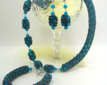 Necklace, a Bracelet and Earrings