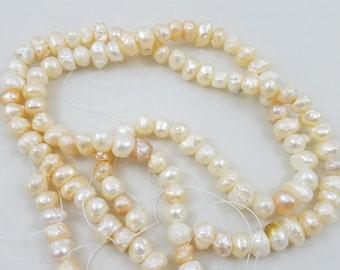 Peach rosebud pearls