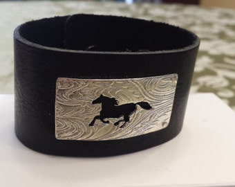 Sterling silver horse on leather cuff