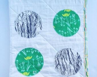 Modern baby quilt in emerald, navy, steel, and lemon
